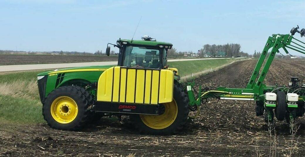 1000 gallon fertilizer tanks on tractor in field