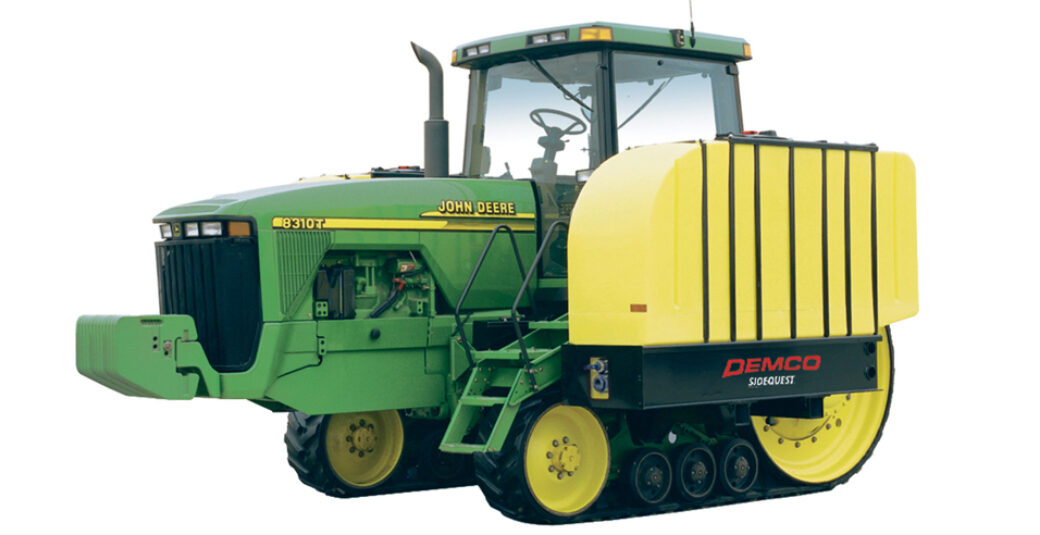 1000 gallon fertilizer tanks on green tractor with tracks