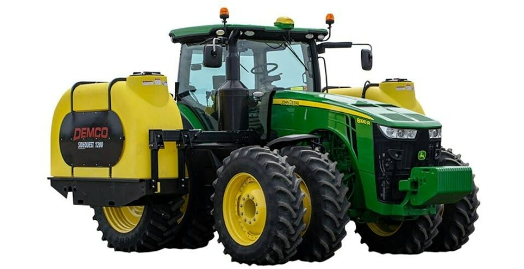 1200 gallon fertilizer tanks mounted on green tractor