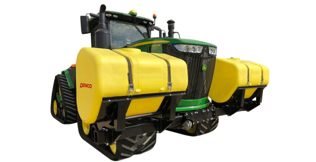 600 gallon fertilizer tanks mounted on green 4WD tractor