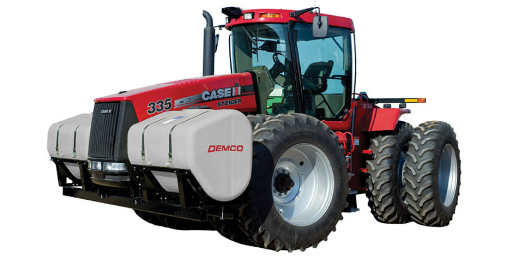 600 gallon fertilizer tanks mounted on red 4WD tractor