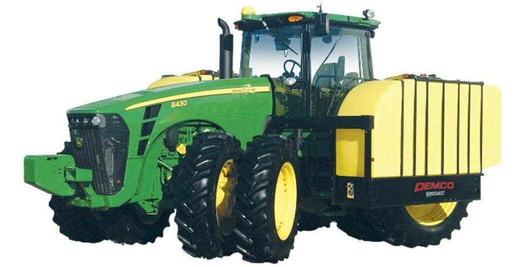 700 gallon fertilizer tanks on green tractor