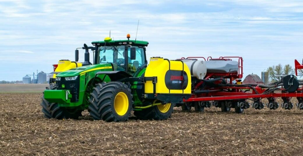 Fertilizer tanks mounted on green tractor