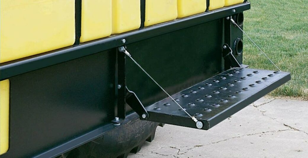 Folding step for tractor with fertilizer tanks
