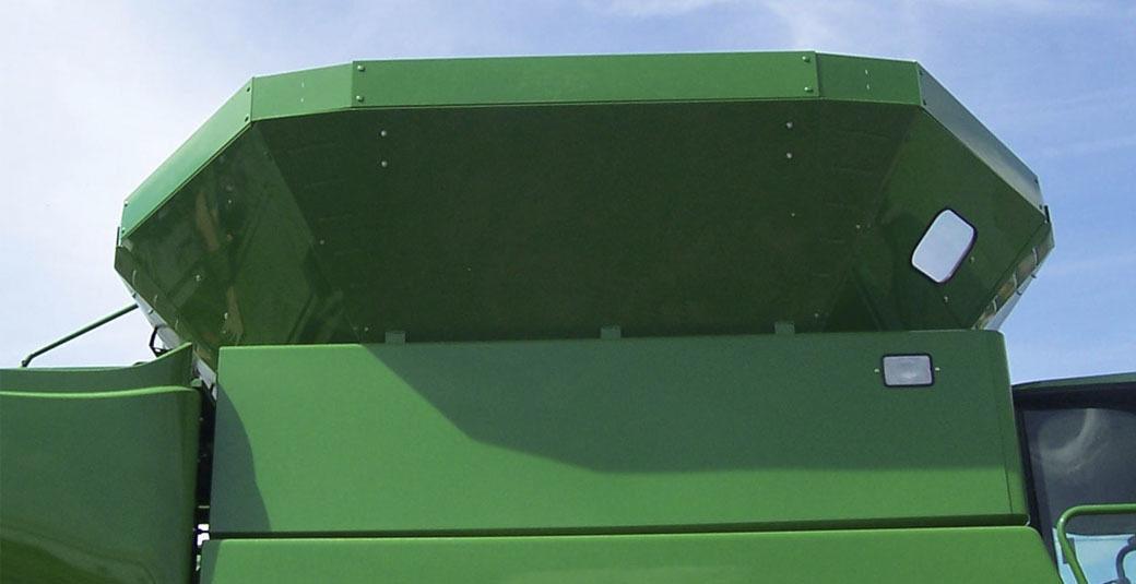A green combine grain tank extension