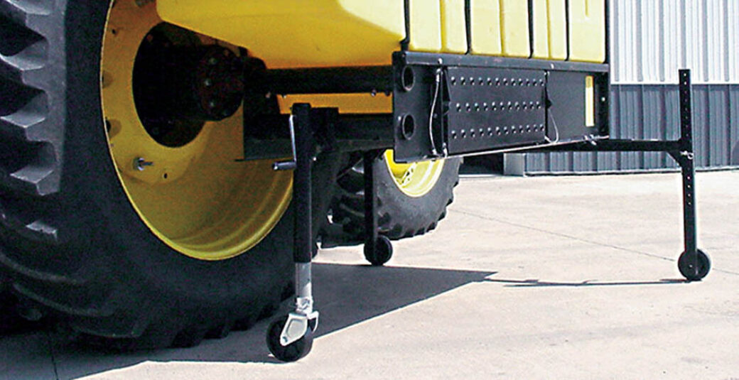 Rollaway jack stand for tractor with fertilizer tanks