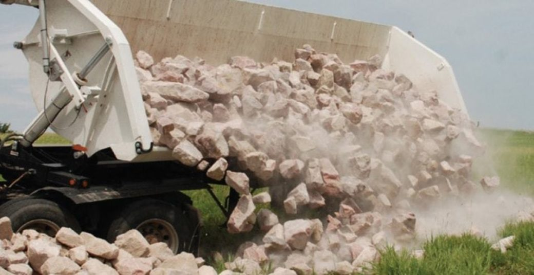 Side Dump trailer dumping rock