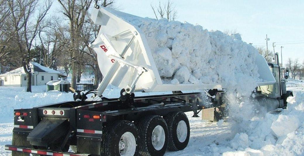 Side Dump trailer dumping snow