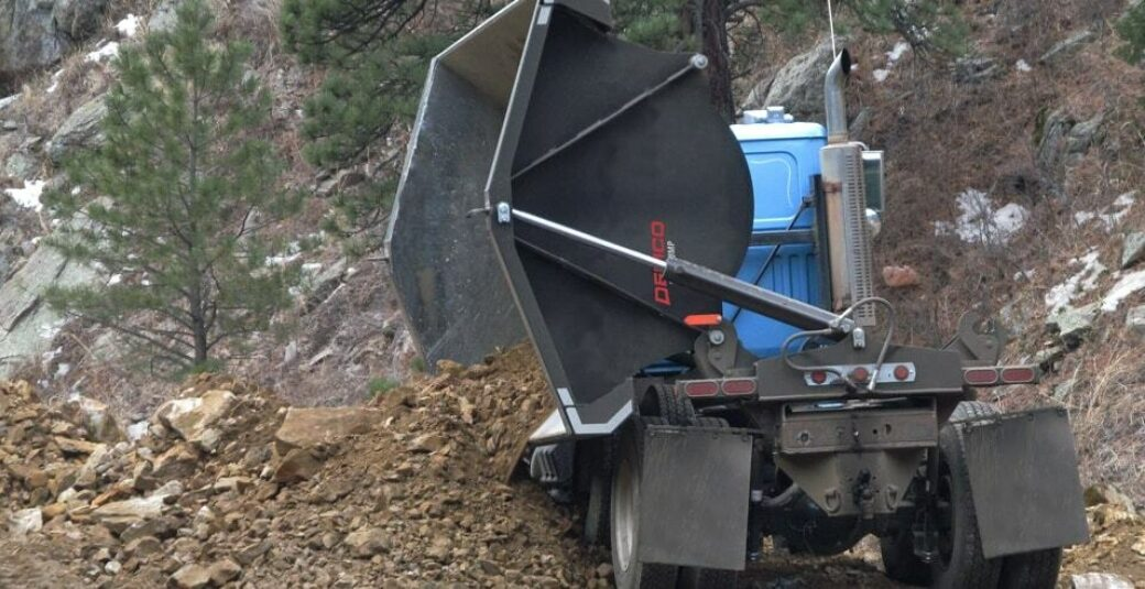 Side dump truck box dumping