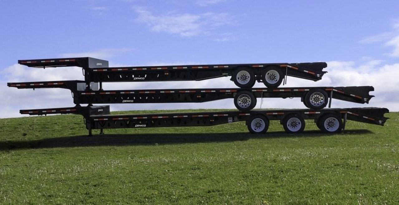 3 steel dropdeck trailers on top of each other
