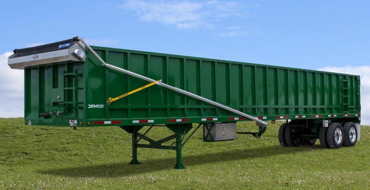 Green scrao trailer on grass