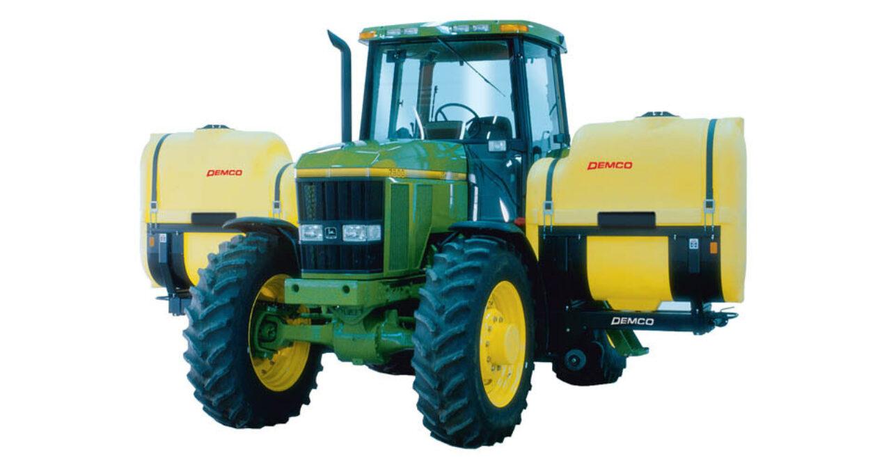 Fertilizer tanks on mechanical drive tractor