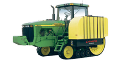 Smaller 1000 gallon fertilizer tanks on green tractor with tracks