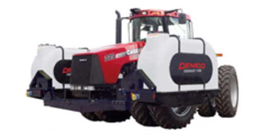 A red tractor with 2 tractor mounted fertilizer tanks