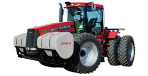 Smaller 600 gallon fertilizer tanks mounted on red 4WD tractor