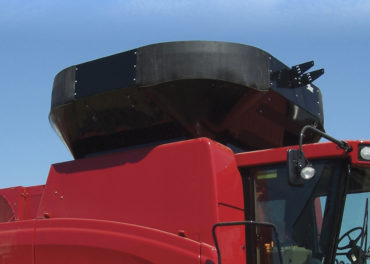 A red combine grain tank extension