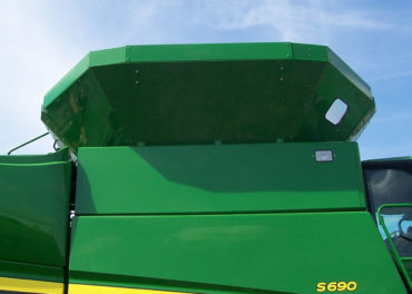 A green combine grain tank extension