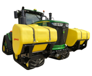 Green tractor with tractor mounted fertilizer tanks